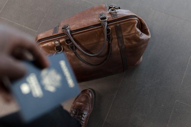 A passport and a brown bag
