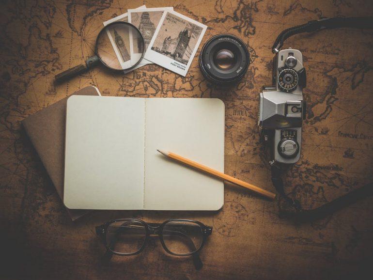 Digital nomad's equipment - notebook, binoculars, etc.