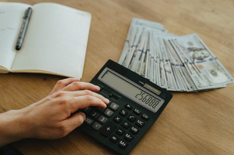 A person calculating their finances