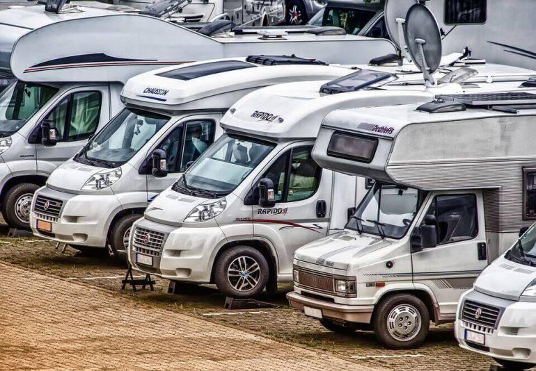 Multiple parked camper vans