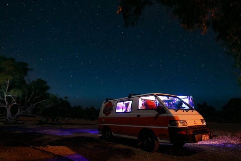 Van parked under the stars
