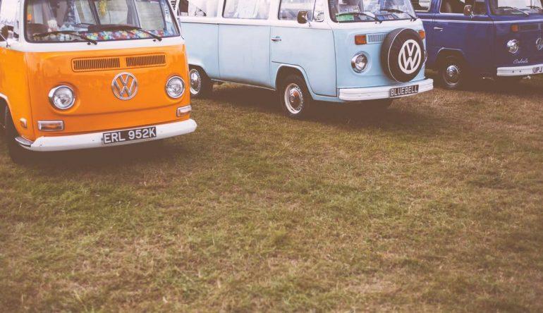 Three old school vans parked