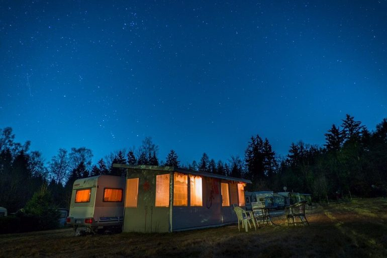 A van under a night sky
