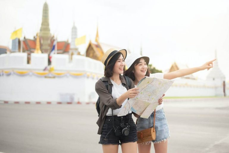 Two women sightseeing.
