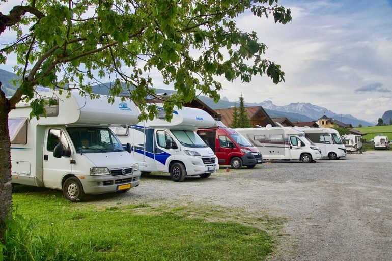 Multiple vans parked on a parking truck stop