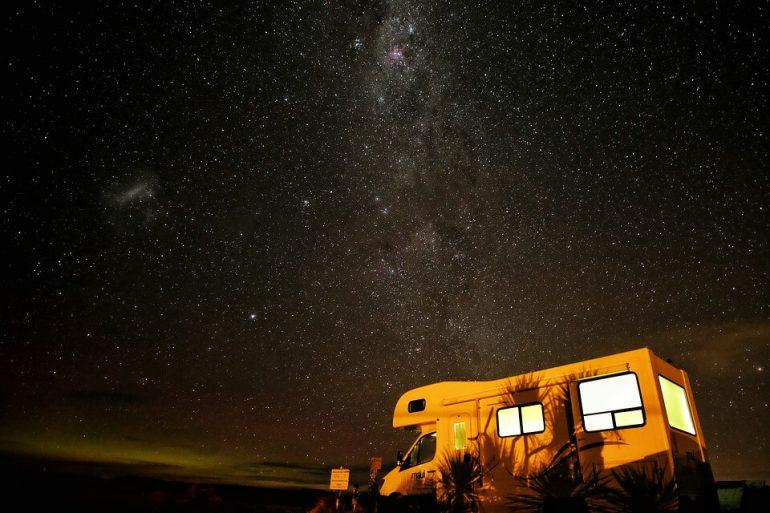 A van parked under the stars