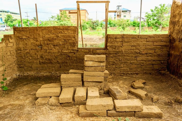 Building a house with mud and brick