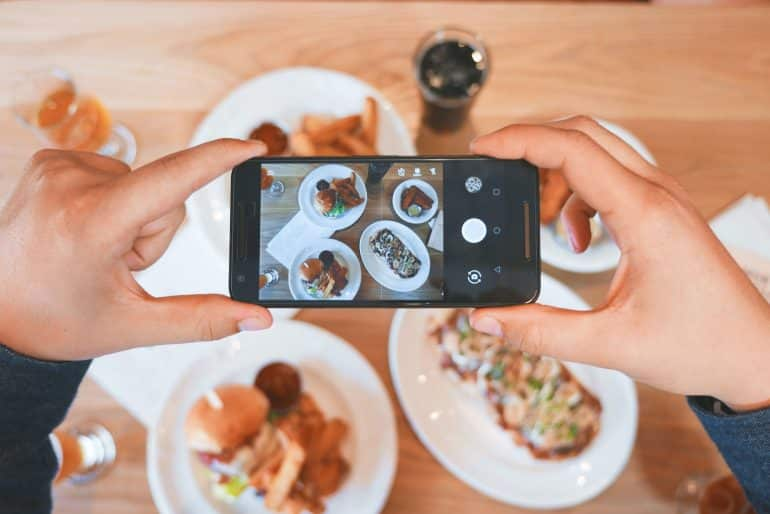 a person taking a picture of their meal