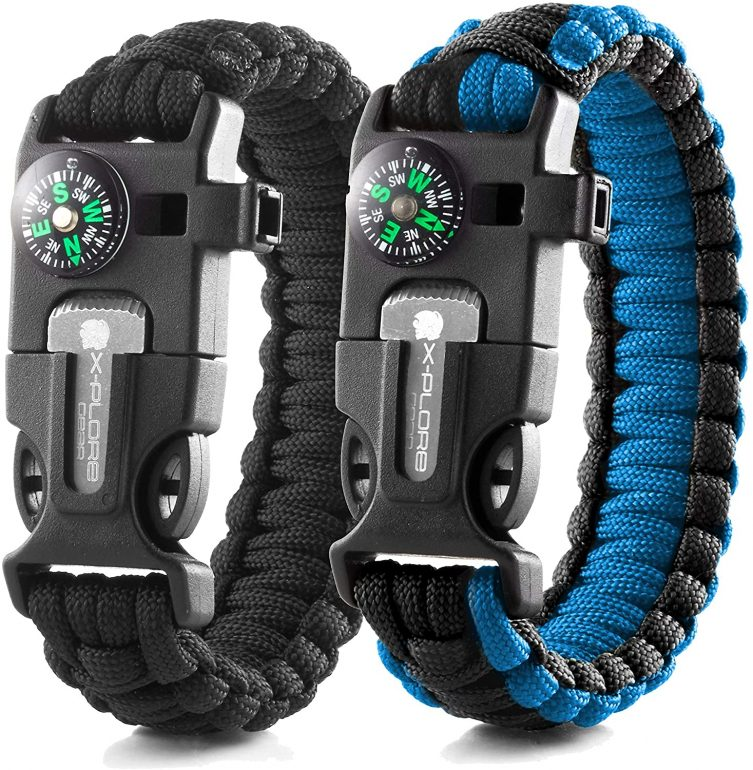 a black and blue survival bracelet with a compass