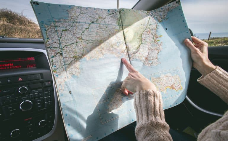 a woman looking at a map